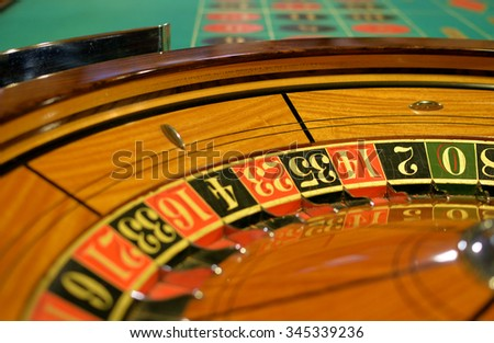 shallow focus roulette wheel and table - stock photo