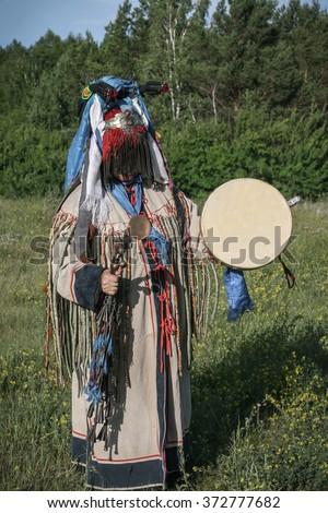 shaman doing authentic ritual of summoning spirits. - stock photo