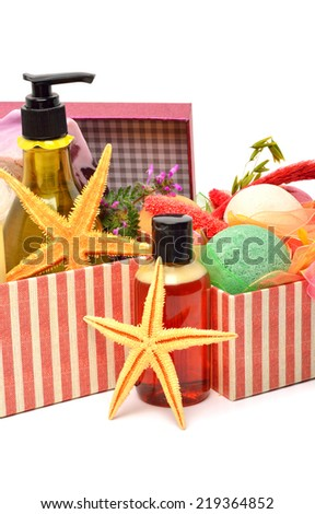 Shampoo, gel bottles, bath bombs with starfishes in gift boxes isolated on white - stock photo