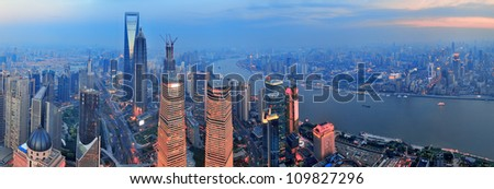 Shanghai aerial view with urban architecture and sunset panorama - stock photo