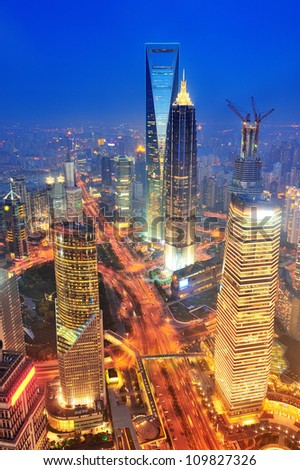 Shanghai aerial view with urban architecture at dusk - stock photo
