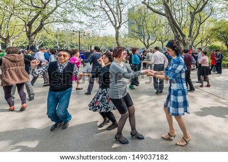 SHANGHAI - APRIL 7: group of people dancing in fuxing park on april 7th, 2013 in Shanghai - stock photo