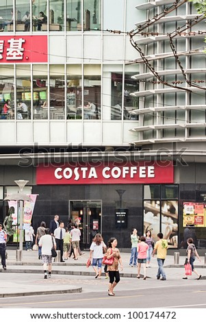 SHANGHAI-AUG. 31; 2009. Costa coffee shop on Aug. 31, 2009 in Shanghai. Costa was founded by Sergio and Bruno Costa in 1971 and runs 785 stores in the UK and over 300 internationally in 24 countries. - stock photo