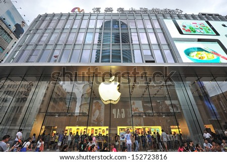 SHANGHAI - AUG 22: people walking in front of Apple store on Nanjing road on August 22, 2013 in Shanghai, China.This store is one of several stand-alone flagship Apple stores in high-profile locations - stock photo