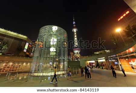 SHANGHAI-AUGUST 16: Night View of Apple store on August 16, 2011 in Shanghai, Pudong District. This is China's second Apple store opened on July 10, 2010. - stock photo