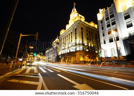 shanghai bund at night ,excellent historical buildings with vehicle trails of light on the street.