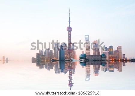 Shanghai bund at sunrise skyline - stock photo