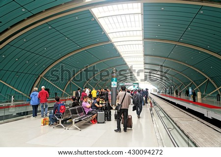SHANGHAI, CHINA - April 20, 2016: Commuters waiting for the Maglev Train - the first high-speed magnetic 'bullet train' in the world - stock photo