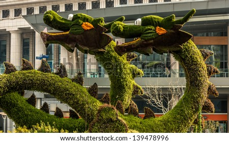 Shanghai, China - April 7, 2013: dragons sculptured trees in pudong  at the city of Shanghai in China on april 7th, 2013 - stock photo