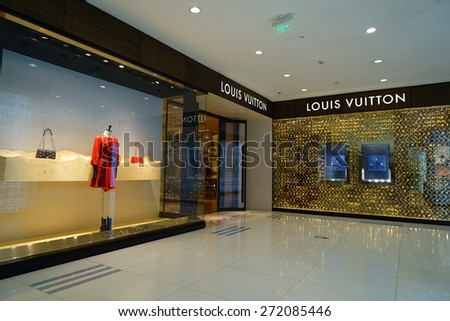 SHANGHAI CHINA- APRIL 22,2015: Exterior of a Louis Vuitton store in IFC luxury shopping mall at lujiazui shanghai.Louis Vuitton, founded in 1854, is the world's leading luxury brand. - stock photo