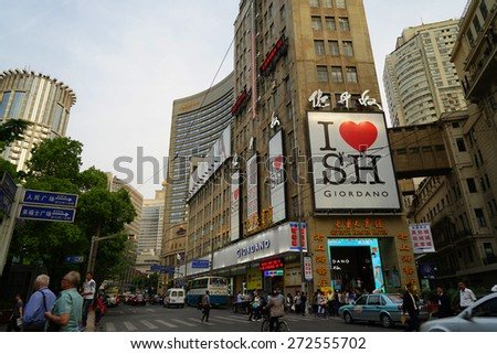 SHANGHAI CHINA - APRIL 25, 2015: Nanjing Road in the weekend in Shanghai.Nanjing Road is the main shopping street of Shanghai and here is one of the world's busiest shopping streets.