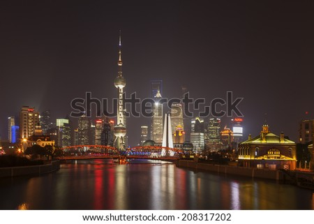 SHANGHAI, CHINA - DEC. 19, 2012: Pudong at night in Shanghai, China. Pudong has become the engine of the economic and social development of Shanghai after two decade of development in China. - stock photo