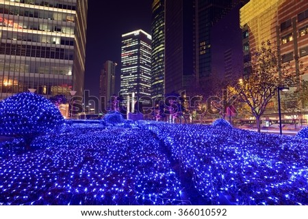 Shanghai, China - December 23, 2014: It's almost Christmas; at night, the streets at Lujiazui Pudong New Area are lit up by the colorful lights. - stock photo