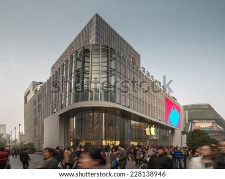 SHANGHAI, CHINA - FEBRUARY, 2014:  Shoppers and tourists pass by the Apple Store on Nanjing Road in Shanghai, China - stock photo