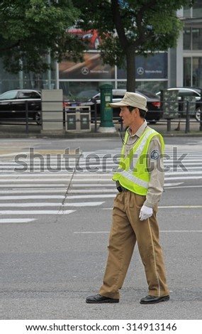 SHANGHAI, CHINA - JULY 2, 2015: traffic officer are controling street motion in Shanghai