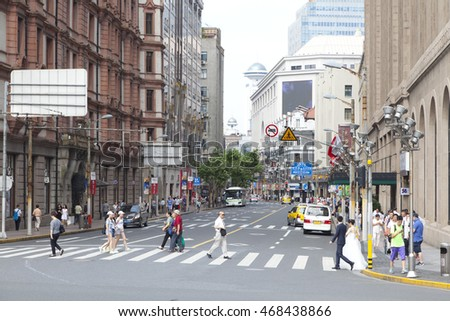 Shanghai,China - June 26,2016 : East Nanjing Road with a lot of tourists walking in Shanghai,China on June 26,2016.