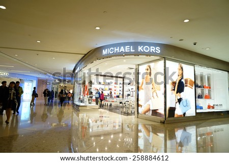 SHANGHAI, CHINA - March 8. 2015: Interior of the IFC Shopping Mall downtown in Pudong Lujiazui. Michael Kors brand store inside Just The international women's day at March 8. 2015 Shanghai, China - stock photo