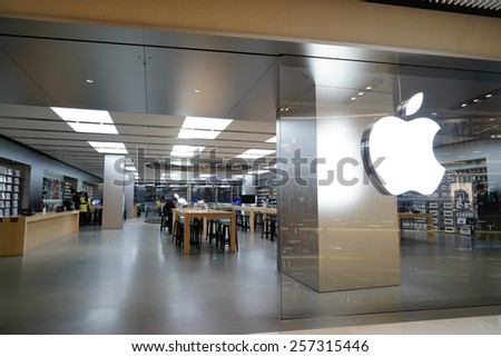 SHANGHAI, CHINA - March 2. 2015: Interior of the new IAPM Shopping Mall downtown in old French Concession. Apple store inside Just after Chinese new year at March 2. 2015 Shanghai, China - stock photo
