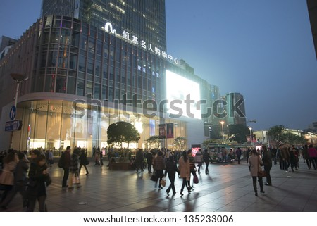 SHANGHAI, CHINA - MARCH 6: Nanjing Road street night view on March 6, 2013 in Shanghai, China of Nanjing Road is 6km long as the world's longest shopping district with 2M visitors daily. - stock photo