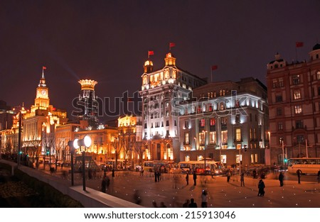 SHANGHAI, CHINA-MARCH 29, 2010: night view of old buildings in the Bund, one of the most famous tourist destinations in Shanghai. - stock photo