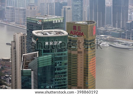 SHANGHAI, CHINA - MARCH 20: Pudong district skyscrapers on March 20, 2016 in Shanghai, China. Pudong is a district of Shanghai, located east of the Huangpu River. - stock photo