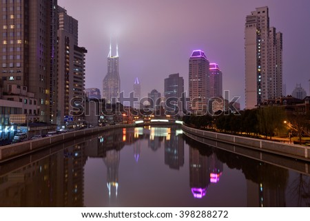 SHANGHAI, CHINA - MARCH 19: Suzhou Creek on March 19, 2016 in Shanghai, China. Suzhou Creek (or Soochow Creek), also called Wusong River, is a river that passes through the Shanghai city centre. - stock photo