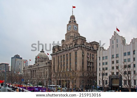 SHANGHAI, CHINA-MARCH 29, 2010: the Shanghai Banking Corporation, the Customs House and the Bank of Communications building in the Bund. one of the most famous tourist destinations in Shanghai. - stock photo