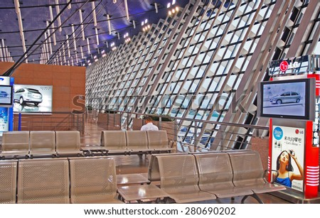 Shanghai, China- May 22, 2007: Business man at the Pudong airport. This is one of the more crowded airport in China with more than 50 million passengers per year. - stock photo