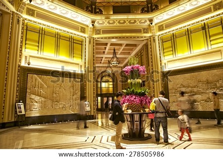 SHANGHAI, CHINA - MAY 2, 2015: Lobby of the Peace Hotel with visitors. It is one of the most traditional landmarks of the city and a classic destination. Shanghai attracts more tourists every year. - stock photo