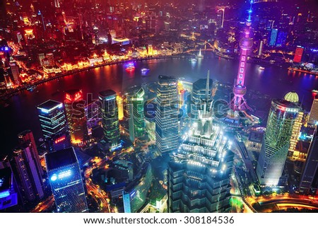 SHANGHAI, CHINA -MAY 24, 2015. Oriental Pearl Tower at the nighttime. Tower  470 meter the Oriental Pearl is one of Shanghai's tallest buildings, located at Lujiazui finance and trade zone in Pudong. - stock photo