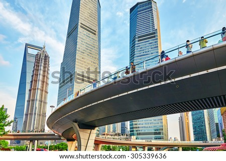 SHANGHAI,, CHINA- MAY, 24, 2015: Skyscrapers, city building of Pudong, peoples on the street, tourists and ordinary life of the big city. Shanghai, China.