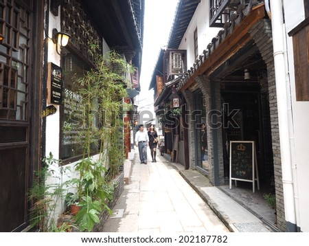 SHANGHAI, CHINA - MAY 21: Tourist visits Zhujiajiao on May 21, 2014 in Shanghai. Zhujiajiao is a well-known ancient water village  as Shanghai's version of Venice.