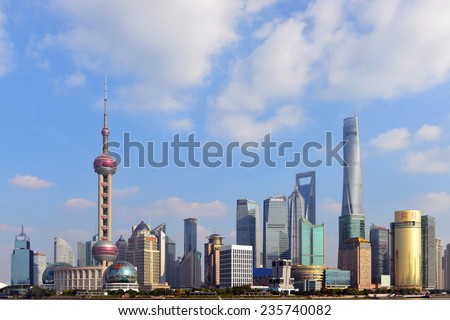 SHANGHAI, CHINA - NOV 20, 2014: The magnificent skyline of Shanghai on a sunny day, as seen from across the Bund.  Shanghai is a global financial center and the world's busiest container port. - stock photo