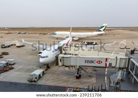 SHANGHAI, CHINA - OCT 24, 2014: Cathay Pacific and Malaysian Airlines planes are parked in Shanghai Pudong International Airport. The airport is  a major international hub for Air China. - stock photo