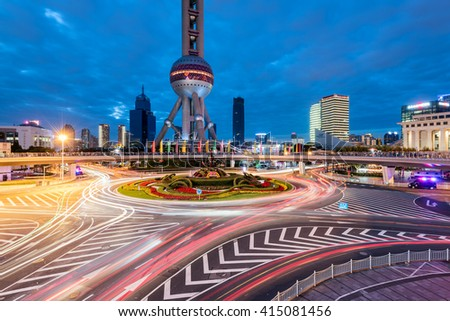 Shanghai, China - Oct 6, 2015: Elevated walkways and roundabouts of Lujiazui in the futuristic high rise district of Pudong. - stock photo