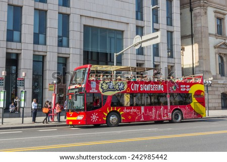 SHANGHAI, CHINA - OCT 24, 2014: Shanghai Sightseeing Open-top tour bus with audio guide, various languages available, is the great way see the Shanghai's major sights in short time.  - stock photo