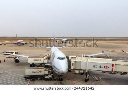 SHANGHAI, CHINA - OCT 24, 2014: United Airlines plane is parked in Shanghai Pudong International Airport. The airport is a major international hub for Air China. - stock photo