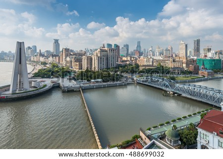Shanghai, China - October 23, 2013: Aerial view of the Bund with Waibaidu bridge and Monument to the People's Heroes, Shanghai, China.