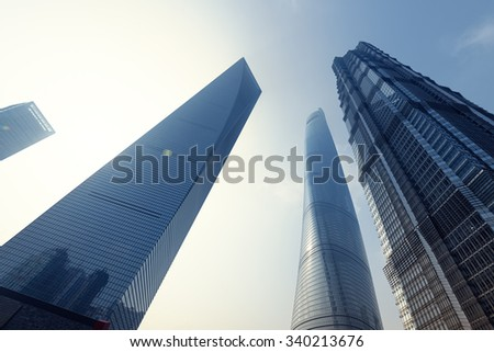 Shanghai, China: October9, 2015. Sunrise behing the Shanghai World Financial Centre, Shanghai Tower and Jin Mao Tower at Lujiazui. Shanghai Tower is newest and the tallest of a group of three. - stock photo