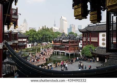 Shanghai, China - October 16, 2015: Traditional Chinese architecture in Yuyuan Garden. Yuyuan Gardens is an extensive Chinese garden located in the northeast of the Old City of Shanghai, China. - stock photo