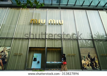 SHANGHAI, CHINA - Sept. 3, 2015: Miu Miu store at night. Miu Miu is Prada's secret weapon to win China's young luxury shoppers with its edgier image is propelling Prada's growth. - stock photo