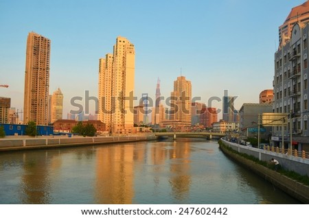 SHANGHAI, CHINA, SEPTEMBER 2, 2013: view of the riverside and cityscape of shanghai during late afternoon.