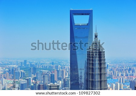 Shanghai city aerial view with urban architecture and blue sky in the day.