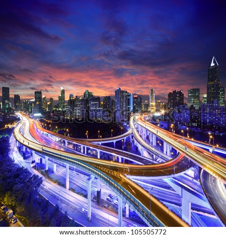 Shanghai City at sunset with light trails - stock photo
