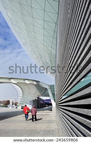 SHANGHAI-DEC. 7, 2014. Entrance Mercedes-Benz Arena. Former World Expo Cultural Center, indoor arena located on former grounds Expo 2010, Pudong, Shanghai owned and operated by AEG-OPG joint venture.  - stock photo