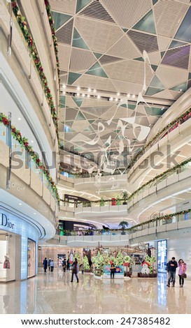 SHANGHAI-DEC. 2, 2014. Interior IFC shopping mall. It occupies a prominent position southeast of the Lujiazui roundabout, across the Oriental Pearl Tower and across the road from Super Brand Mall.  - stock photo