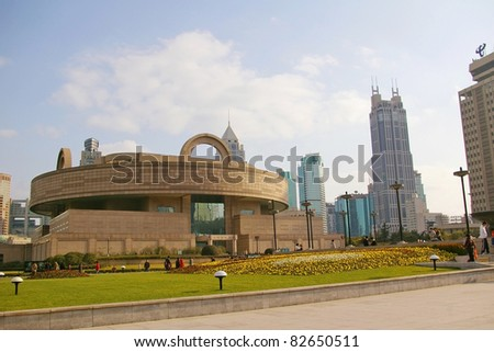 Shanghai downtown at day time, with Shanghai Museum background. - stock photo