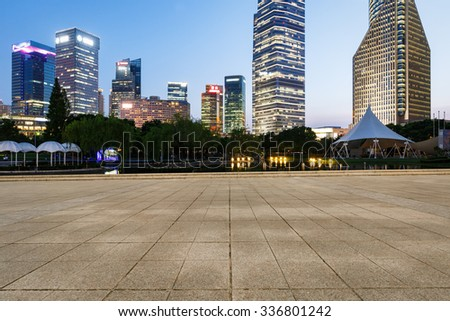 Shanghai Empty square and modern buildings in the evening - stock photo