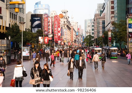 SHANGHAI, FEB 23: Shopping in East Nanjing Road on Feb 23, 2011. Nanjing Road is the main shopping street in Shanghai and one of the world's busiest commercial streets. - stock photo