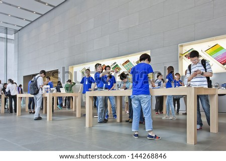 SHANGHAI-JUNE 6. Apple store. Shortage of retail stores and authorized resellers leaves room for unlicensed Apple resellers with bad consumer experiences as a common result. Shanghai, June 6, 2013. - stock photo